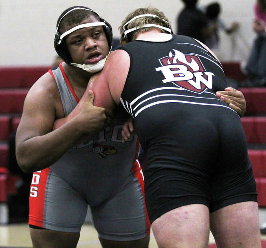 Alton's Kyle Hughes (left), shown wrestling Belleville West's Dustin Olmstead in a dual Dec. 20 at Granite City, pushed his record to 19-2 with a runner-up finish at 285 pounds Saturday at the Red Schmitt Invite at Granite City. Photo: Greg Shashack / The Telegraph