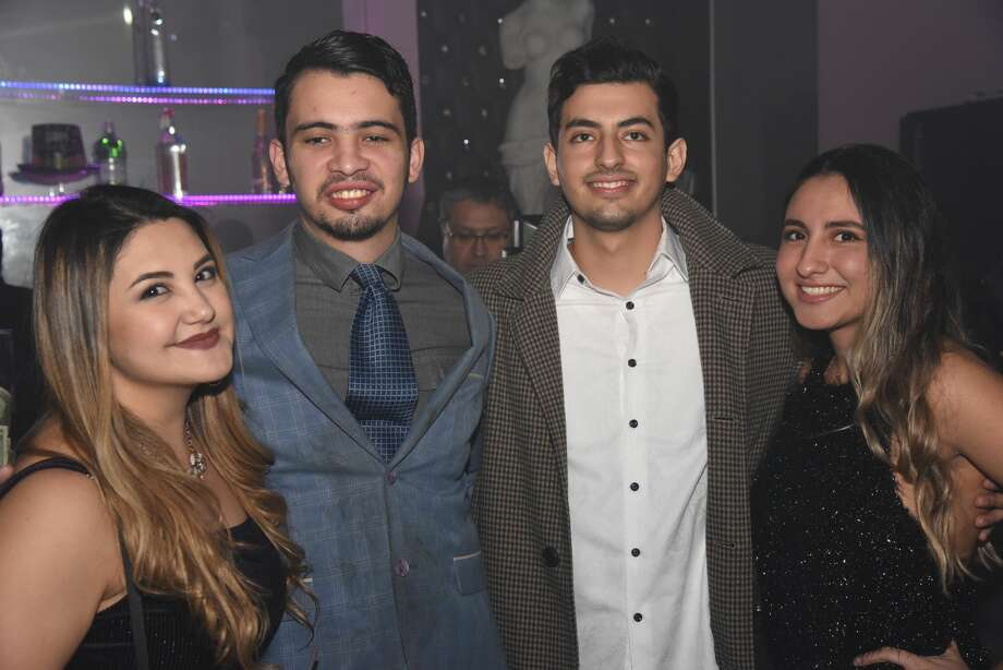 Attendees pose for a photo during the Dolce Nightclub New Years Party. Photo: Christian Alejandro Ocampo