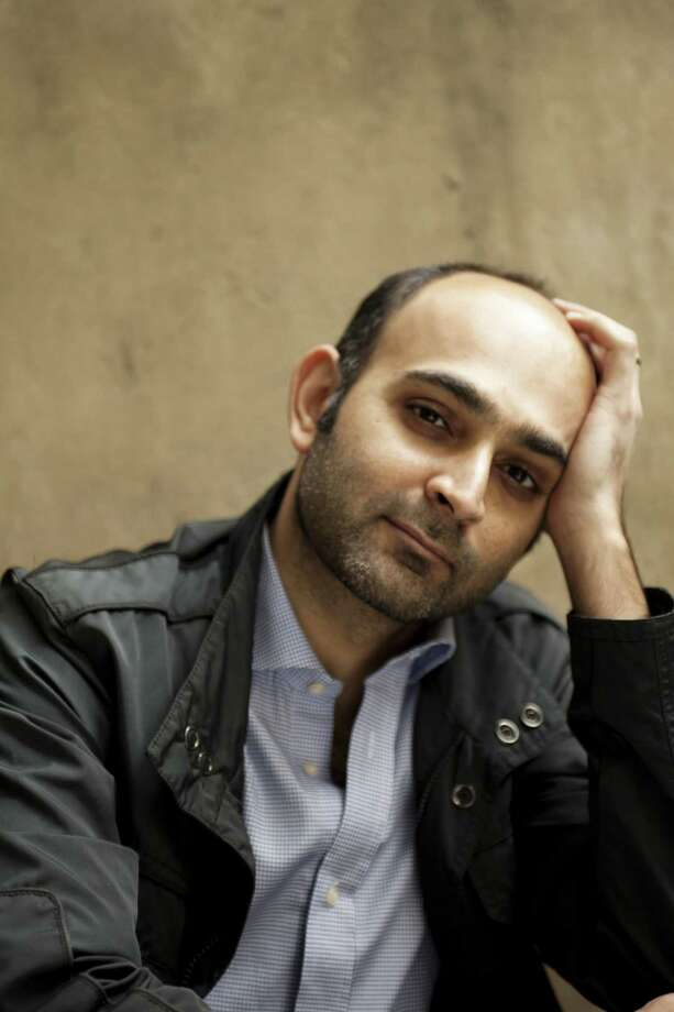 "Mohsin Hamid, seen here, is the author of ""Exit West,"" an award-winning novel about two refugees who find life and love on the run. His book is the focus of WestportREADS, which features a series of related events, including a discussion on ""Behold the Dreamers,"" by Imbolo Mbue, at Westport Library on Jan. 15. (""Exit West"" will be discussed at the library on Thursday, Jan 24.) Photo: Jillian Edelstein / Camera Press / Contributed Photo / © CAMERA PRESS"