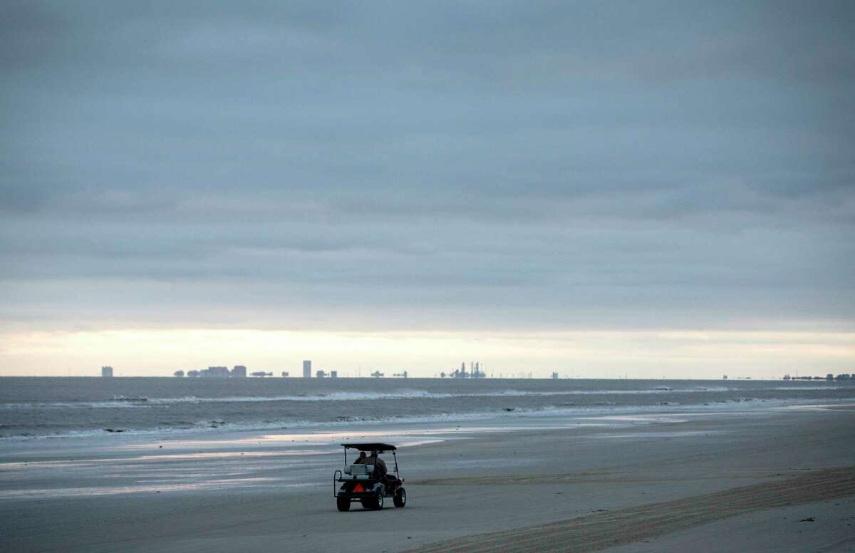 Harry Monceaux and his wife Charlotte Monceaux drive home on the beach, Friday, Dec. 14, 2018, in Crystal Beach.