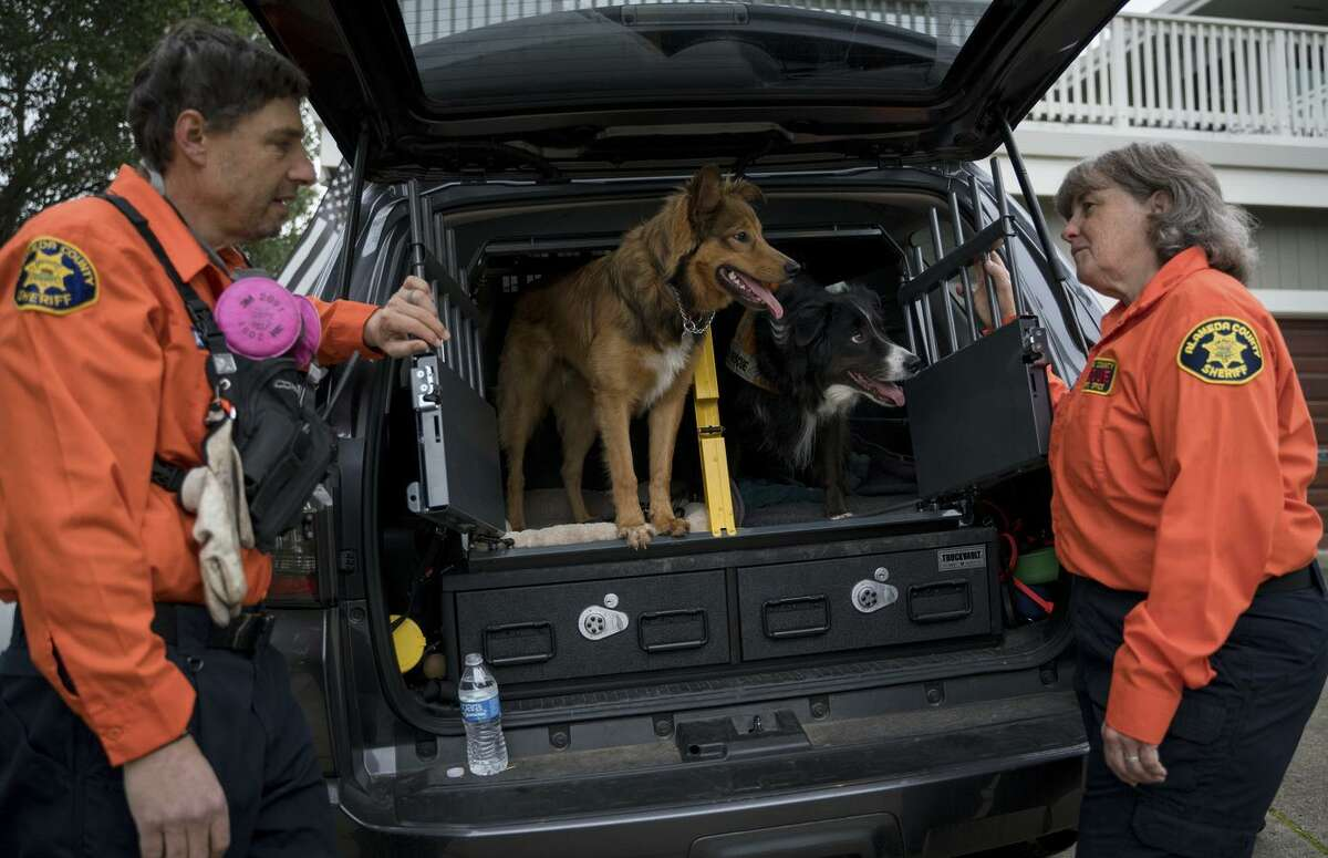 Andrew Rateaver and Alyson Hart, both retired Berkeley police officers, cut short a stay at their Lake Tahoe cabin to pitch in as search and rescue volunteers in Butte County.