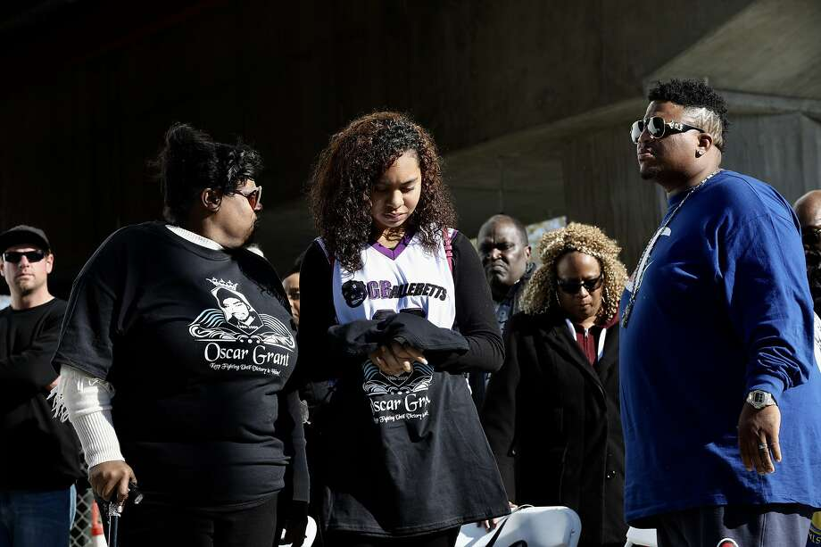 Tatiana Grant (center), daughter of Oscar Grant III, prays at the BART Fruitvale Station during a vigil on the 10 year anniversary of Grant's death in Oakland, Calif., on Tuesday, January 1, 2019. Grant III, 22, was fatally shot by a BART police officer during the early hours of New Year's Day a decade ago. Photo: Yalonda M James / The Chronicle