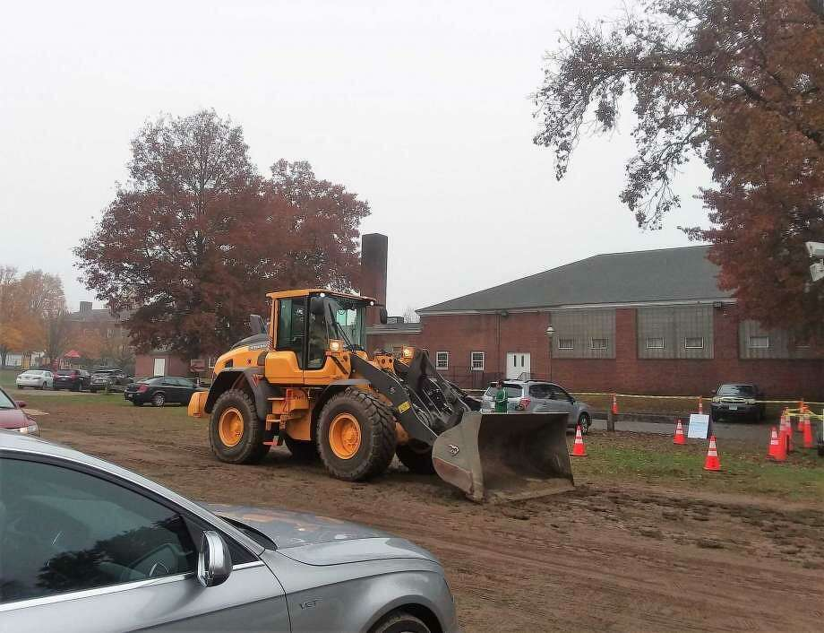 Payloader adding sand to the parking lot for safety at Mary L. Tracy School in Orange, Conn. on Election Day, Tuesday, Nov. 6, 2018.