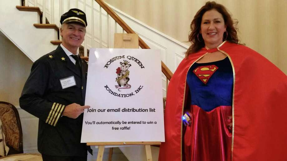 Joe DiChillo (as Sully Sullenberger, a retired American airline captain who successfully landed a disabled jet in the Hudson River in 2009) and Sunny Roper (as DC Universe superhero Supergirl) greeted visitors and sold tickets at the 29th annual Possum Queen Festival, which attracted about 300 visitors for parody skits at the Litchfield Inn, 432 Bantam Road, Litchfield on Tuesday Organizers were expecting to raise between $60,000 and $80,000 to go toward medical expenses for local residents in need. Photo: Noel F. Ambery / For Hearst Connecticut Media
