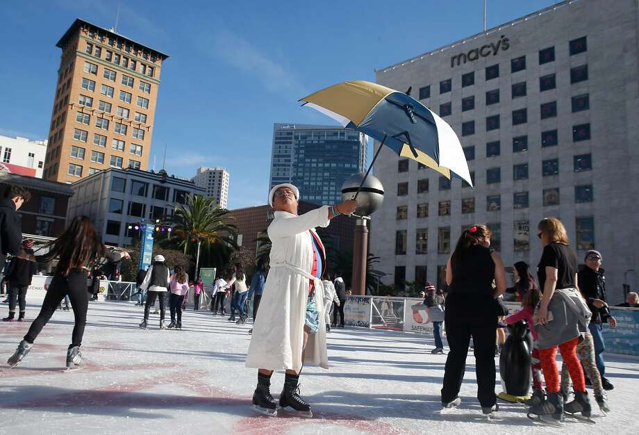 Larry Pascua skates with his umbrella and bathrobe during the New Year's Day polar bear skate and costume contest at the Union Square ice skating rink in San Francisco on New Year's Day 2019. Photo: Paul Chinn / The Chronicle