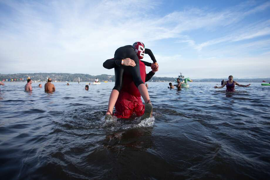 Hundreds of brave souls participate in the 17th annual Matthew's Beach Polar Plunge, Tuesday, January 1, 2019. Photo: By Jeremy Dwyer-Lindgren