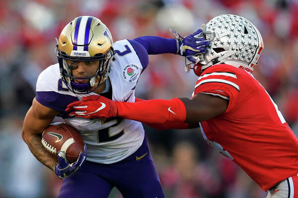 Washington wide receiver Aaron Fuller, left, pushes away Ohio State safety Jordan Fuller during the first half of the Rose Bowl NCAA college football game Tuesday, Jan. 1, 2019, in Pasadena, Calif. (AP Photo/Mark J. Terrill)