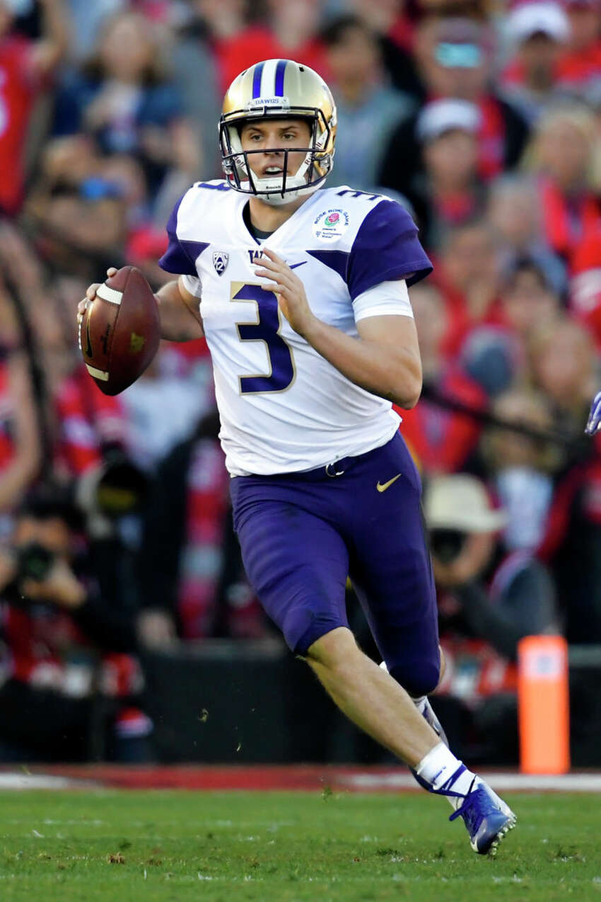 Jake Browning, Quarterback Browning entered the Combine with an abundance of questions about his arm strength and ability to play at the NFL level. In fact, he spent the past two months training to improve that much-scrutinized arm. So did he prove the doubters wrong? According to draft analyst Rob Rang, yes. The Tacoma-based Rang wrote that Browning was accurate, and that the he was putting solid velocity on the ball. He also ran a 4.74-second 40, and excelled in the broad jump and vertical jump. Even so, it's unlikely that Browning was able to tear up scouts' perceptions of him. While he definitely improved his stock, one good throwing performance won't be enough to suddenly vault him into the category of coveted quarterbacks.  DRAFT PREDICTION: Undrafted