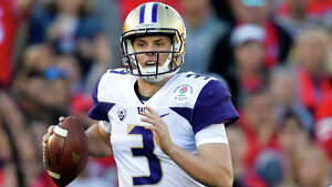Washington quarterback Jake Browning runs against Ohio State during the first half of the Rose Bowl NCAA college football game Tuesday, Jan. 1, 2019, in Pasadena, Calif. (AP Photo/Mark J. Terrill)