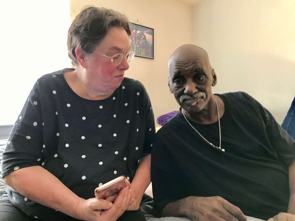 Alison Coleman with her husband, Jay Coleman, who has late-stage liver cancer, at her Guilderland apartment, along with Edward the cat. (Photo by Paul Grondahl)
