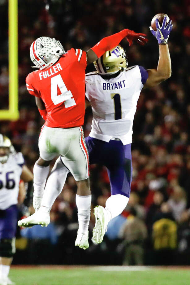 Washington tight end Hunter Bryant, right, catches a pass next to Ohio State safety Jordan Fuller during the second half of the Rose Bowl NCAA college football game Tuesday, Jan. 1, 2019, in Pasadena, Calif. (AP Photo/Jae C. Hong) Photo: Jae C. Hong/AP / Copyright 2019 The Associated Press. All rights reserved