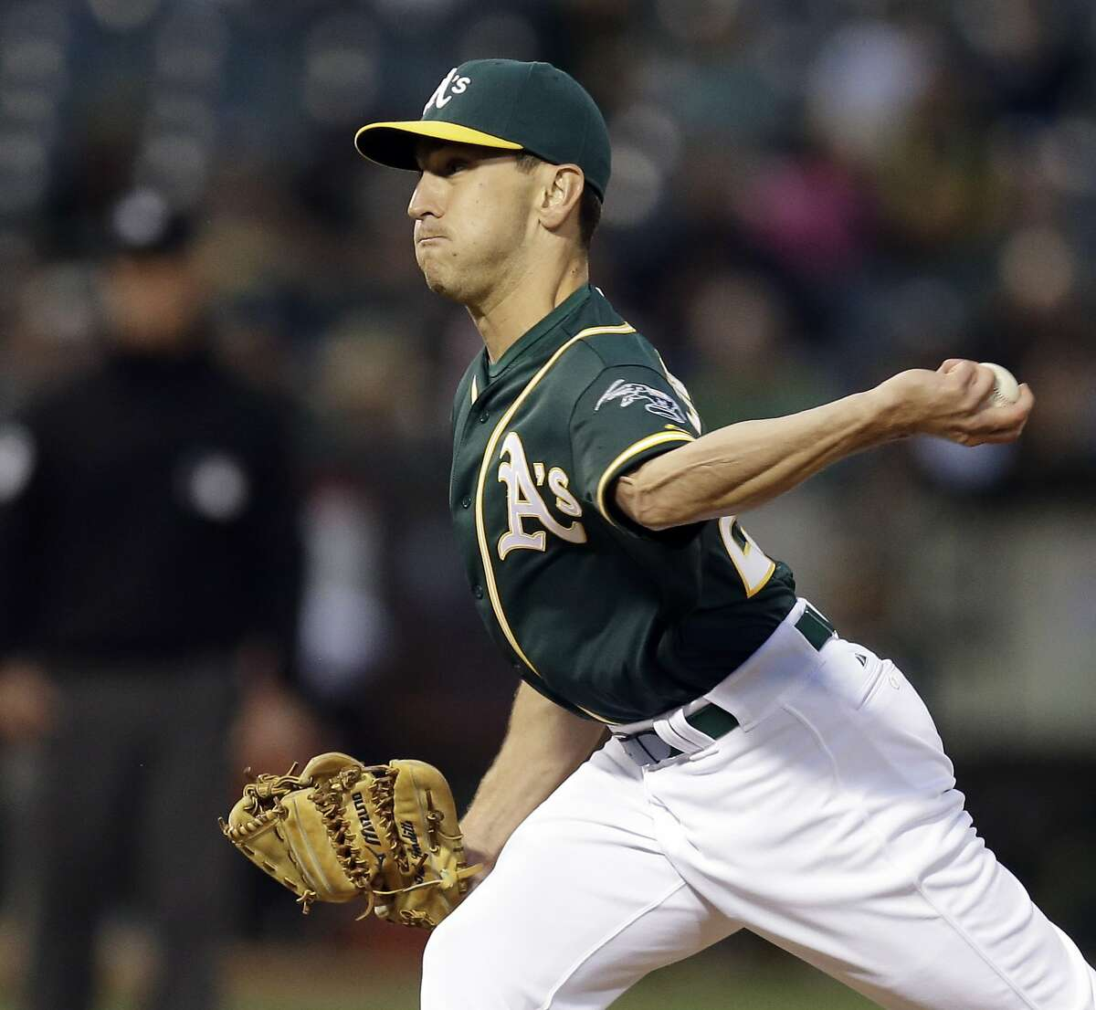 Oakland Athletics pitcher Pat Venditte works against the Texas Rangers in the fourth inning of a baseball game Wednesday, June 10, 2015, in Oakland, Calif. (AP Photo/Ben Margot)