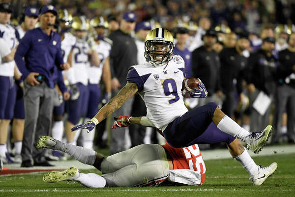 PASADENA, CA - JANUARY 01: Myles Gaskin #9 of the Washington Huskies is stopped by Brendon White #25 of the Ohio State Buckeyes during the second half in the Rose Bowl Game presented by Northwestern Mutual at the Rose Bowl on January 1, 2019 in Pasadena, California. (Photo by Kevork Djansezian/Getty Images)