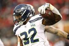 SANTA CLARA, CA - DECEMBER 16: Chris Carson #32 of the Seattle Seahawks rushes with the ball against the San Francisco 49ers during their NFL game at Levi's Stadium on December 16, 2018 in Santa Clara, California. (Photo by Ezra Shaw/Getty Images)