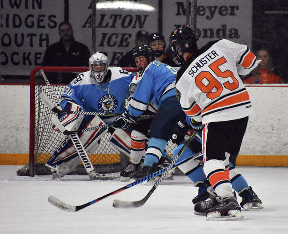 Edwardsville's William Schuster fires a shot through traffic from just inside the blue line in the second period. Photo: Matt Kamp/Intelligencer