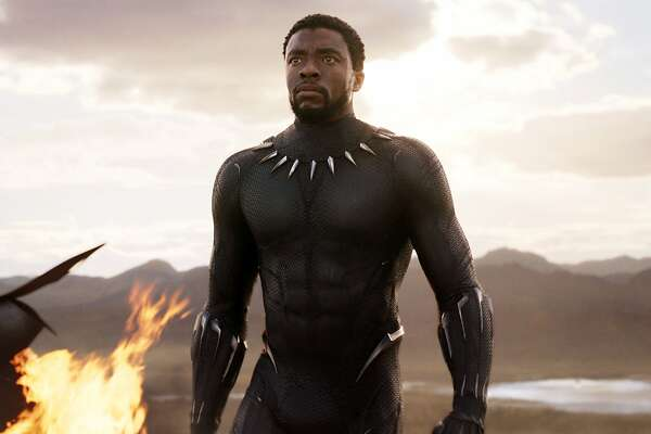 "This image released by Disney and Marvel Studios' shows Chadwick Boseman in a scene from ""Black Panther."" As Hollywood's awards season properly gets under way, ""Black Panther"" is poised to be the first comic book film to be nominated for best picture. (Marvel Studios/Disney via AP)"