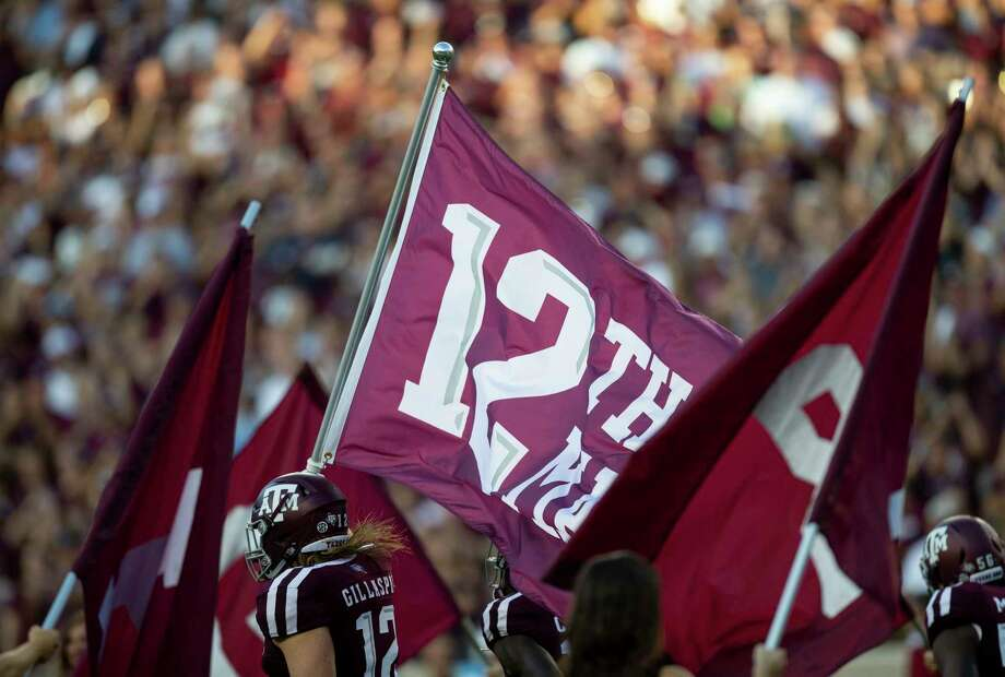 PHOTOS: Can you pass the Texas A&M Aggie quiz?  Texas A&M fullback Cullen Gillaspia (12) carries the 12th Man flag during the team run out before the start of an NCAA college football game Saturday, Sept. 15 2018, in College Station, Texas. (AP Photo/Sam Craft)  >>>Browse through the gallery to see if you can pass the quiz ...  Photo: Sam Craft, Associated Press / Copyright 2018 The Associated Press. All rights reserved.