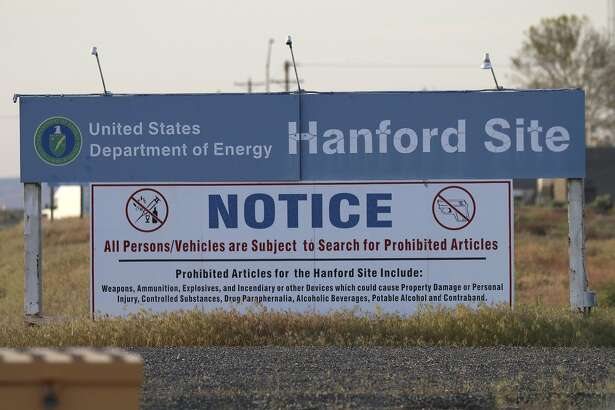 FILE - In this Tuesday, May 9, 2017, file photo, signs are posted by the Hanford Nuclear Reservation in Benton County in Richland, Wash. A Hanford worker got radioactive contamination on his protective clothing during an incident Thursday, May 18, 2017, at an underground waste storage tank. Monitors showed no further contamination on that worker, and all members of the crew were cleared for normal duty. (AP Photo/Manuel Valdes, File)
