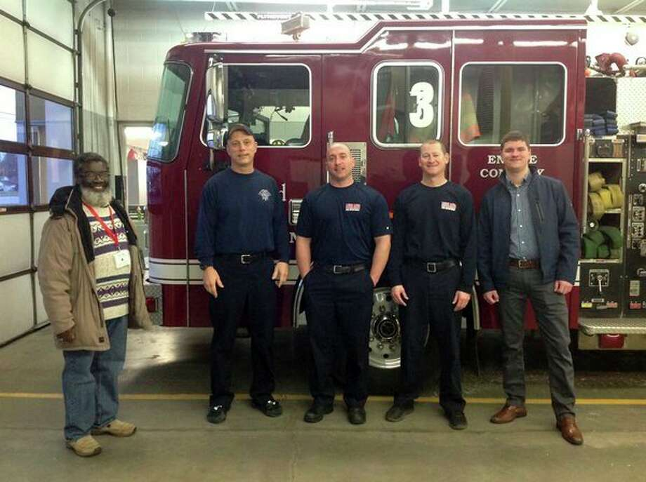 The Midland Morning Rotary Club, represented by Victor Atiemo-Obeng, far left, donated holiday items recently at Midland Fire Station No. 3. The club collected gifts for local police, sheriff, fire and EMS departments. (Photo provided)