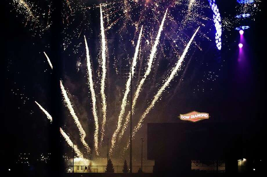 Fireworks explode over Dow Diamond after the countdown to midnight during the annual Midnight on Main celebration. (Katy Kildee/kkildee@mdn.net)