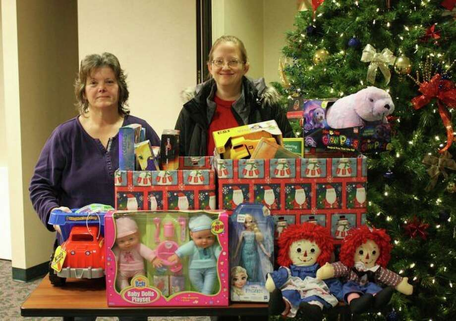This Christmas the staff of Marlette Regional Hospital donated three boxes of toys to Marlette Toys for Tots for distribution during the holiday season. Long-term employee Janis Maynard has proudly organized this hospital toy drive for the past 38 years. Pictured, Maynard, left, presents Marlette Toys for Tots representative Theresa Moshier with the toys just in time for Christmas. (Submitted Photo)