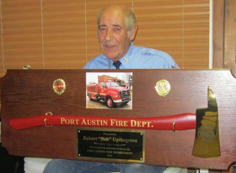 Bob Upthegrove recently was honored for his contributions to the Port Austin Fire Department. (Fred Davis/For the Tribune)