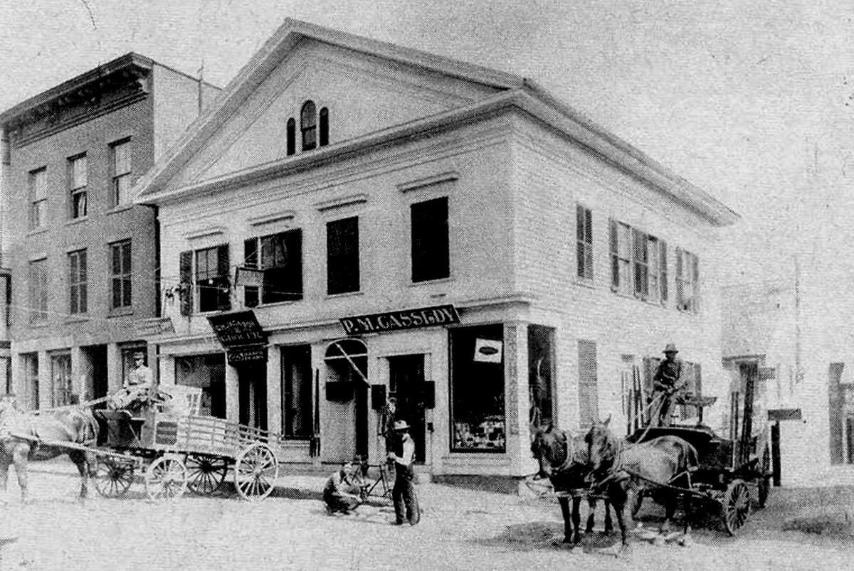 The P.M. Cassedy store appears to be a busy spot along Bank Street in New Milford at the time this photograph was taken some time in the late 1800s. The store was located just about across the street from where Bank Street Theater is now. The photograph at one time was in a collection owned by New Milford resident Frank L.