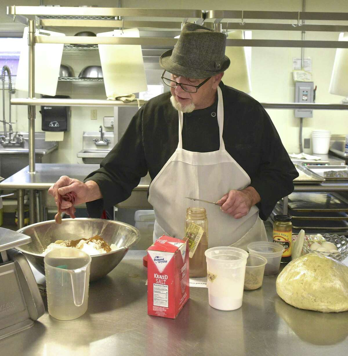 Chef Blythe Roberts, head instructor with the Community Culinary School of Northwestern recently prepares cookie dough for assorted cookies the school sold for the holidays.