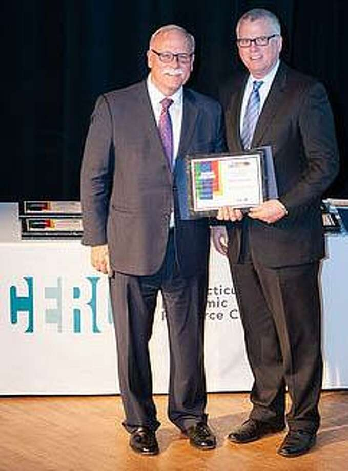 Makery Coworking in New Milford was recently recognized by The Connecticut Economic Resource Center, Inc. as one of 18 honorees who have contributed to the state's economy. Makery founder Tony Vengrove, right, is shown receiving the award. Photo: Courtesy Of Makery Coworking / The News-Times Contributed