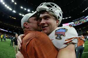 NEW ORLEANS, LOUISIANA - JANUARY 01:  Head coach Tom Herman celebrates with Sam Ehlinger #11 of the Texas Longhorns after defeating Georgia Bulldogs 28-21 during the Allstate Sugar Bowl at Mercedes-Benz Superdome on January 01, 2019 in New Orleans, Louisiana.