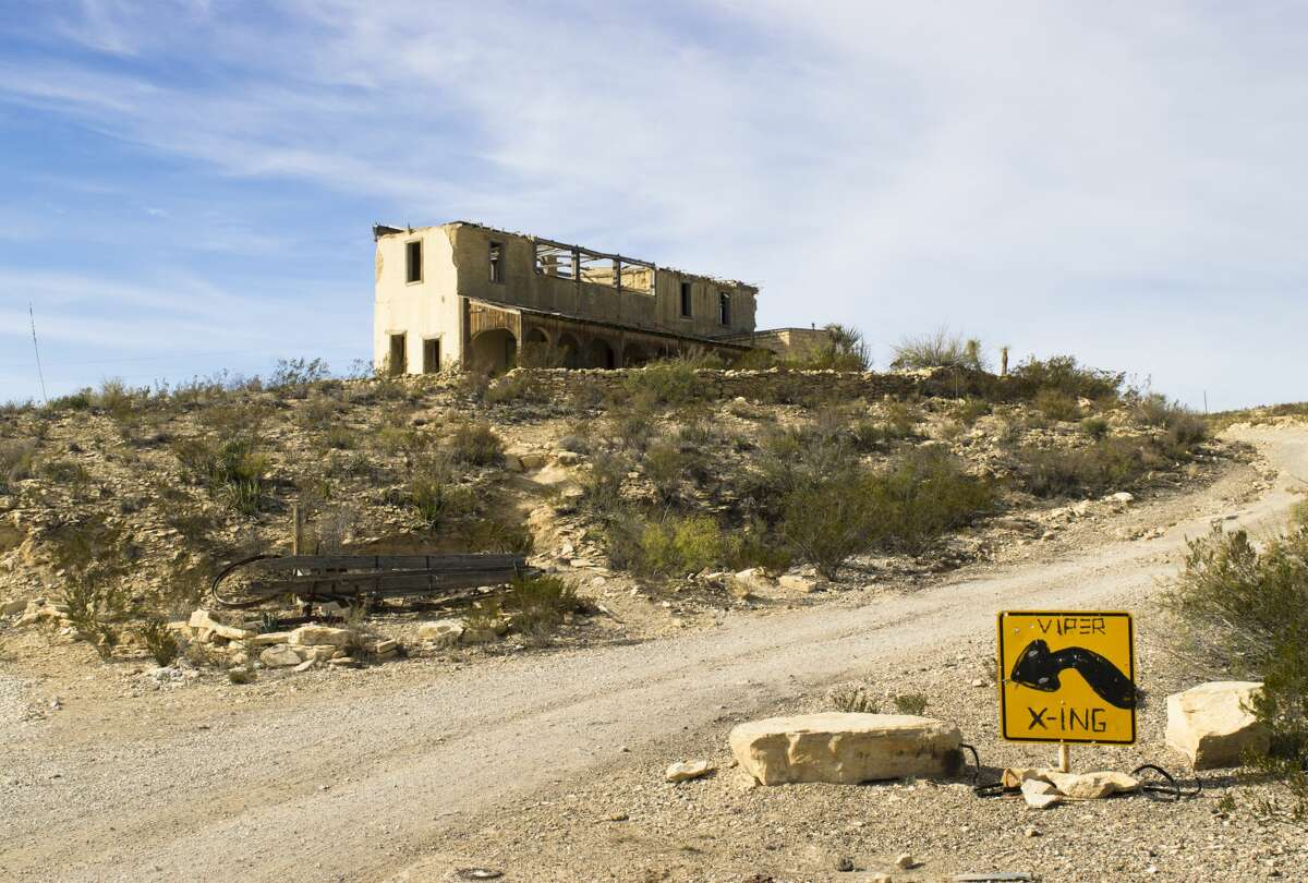 An old, dilapidated building in Terlingua, Texas. The small town used to be known for quicksilver mining and is right outside of Big Bend National Park. A viper crossing sign warns those who enter.