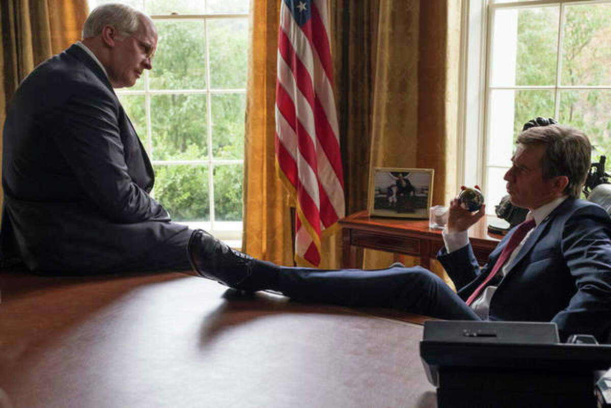 """This image released by Annapurna Pictures shows Christian Bale as Dick Cheney, left, and Sam Rockwell as George W. Bush in a scene from """"Vice."""""""