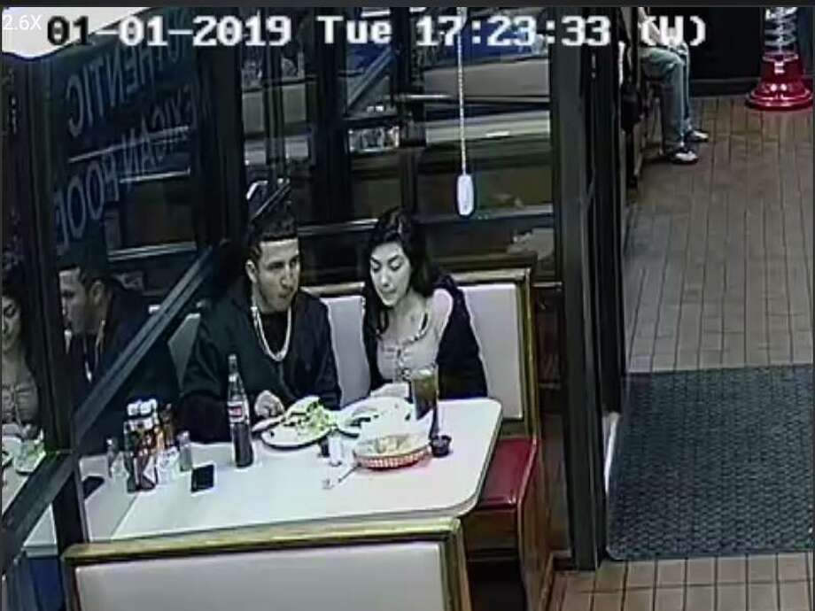 A couple was caught on camera allegedly leaving Ruthie's Mexican Restaurant before paying their $27 bill, restaurant Owner Nas Valencia said. Further surveillance footage shows the couple was stuck outside for about 30 minutes while they waited for someone to come jump their car so they could leave, Valencia said. Photo: Courtesy Of Ruthie's Mexican Restaurant