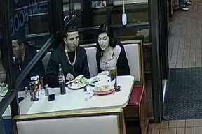 A couple was caught on camera allegedly leaving Ruthie's Mexican Restaurant before paying their $27 bill, restaurant Owner Nas Valencia said. Further surveillance footage shows the couple was stuck outside for about 30 minutes while they waited for someone to come jump their car so they could leave, Valencia said.