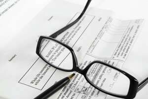Legal documents. law. glasses. policies EYEGLASSES, INSURANCE PAPERS