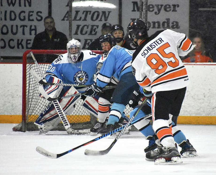 Edwardsville's William Schuster fires a shot through traffic from just inside the blue line during the second period of Tuesday night's Mid-States game against Francis Howell at the East Alton Ice Arena. Photo: Matt Kamp | Fot The Telegraph