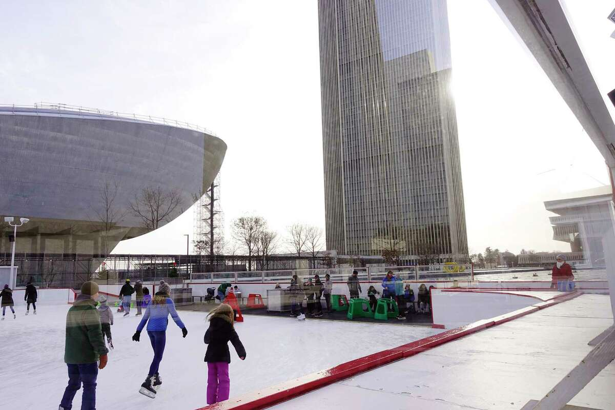 Children and adults skate at the ice rink at the Empire State Plaza on Wednesday, Jan. 2, 2019, in Albany, N.Y. (Paul Buckowski/Times Union)