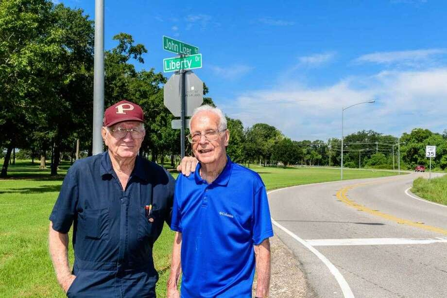 John Mark, president of the Pearland Historical Society, right, shown with society first vice president Luther Cunningham, has always spoken out about the importance of preserving the city's heritage, such as when he successfully urged the city in the fall to retain early Pearland settler John Lizer's name on part of a city road.