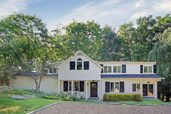 The updated antique colonial farmhouse at 185 Compo Road South sits on a 0.61-acre level and gently sloping interior lot only about a mile from Compo Beach.