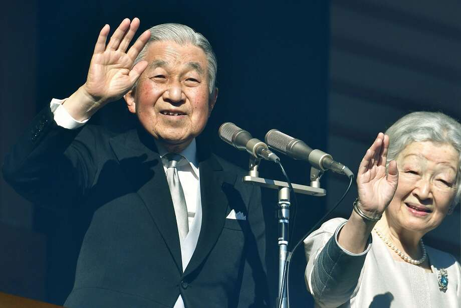 Japan's Emperor Akihito, 85, and Empress Michiko wave to more than 150,000 well-wishers eager to see his final New Year's appearance before abdicating on April 30. Photo: Kazuhiro Nogi / AFP / Getty Images