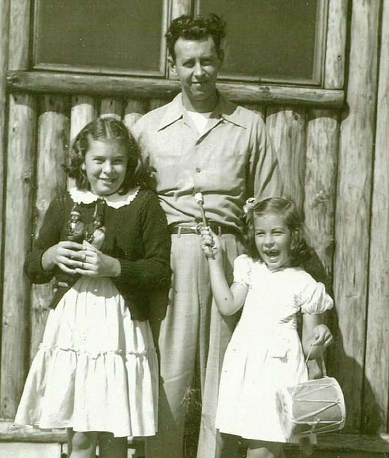 Ed Flore is with his two daughters, Bev on the left and Sally on the right. Ed and his brother Andrew had a produce business on Gordon Street where the H Hotel is now. Later Ed and Dorothy owned a motel in Clare. When they retired, they returned to Midland to enjoy their three grandsons, Jeffrey, Brian and Craig. 'Joyous is the word I come up with when I speak about my grandfather Ed Flore,'Craig said.
