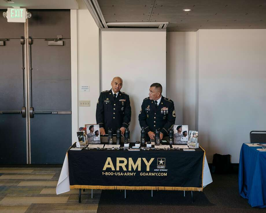 Recruiters appear at a job fair in Seattle. After falling 6,500 soldiers short of its goal, the Army is trying a new strategy. Photo: Ian C. Bates / New York Times