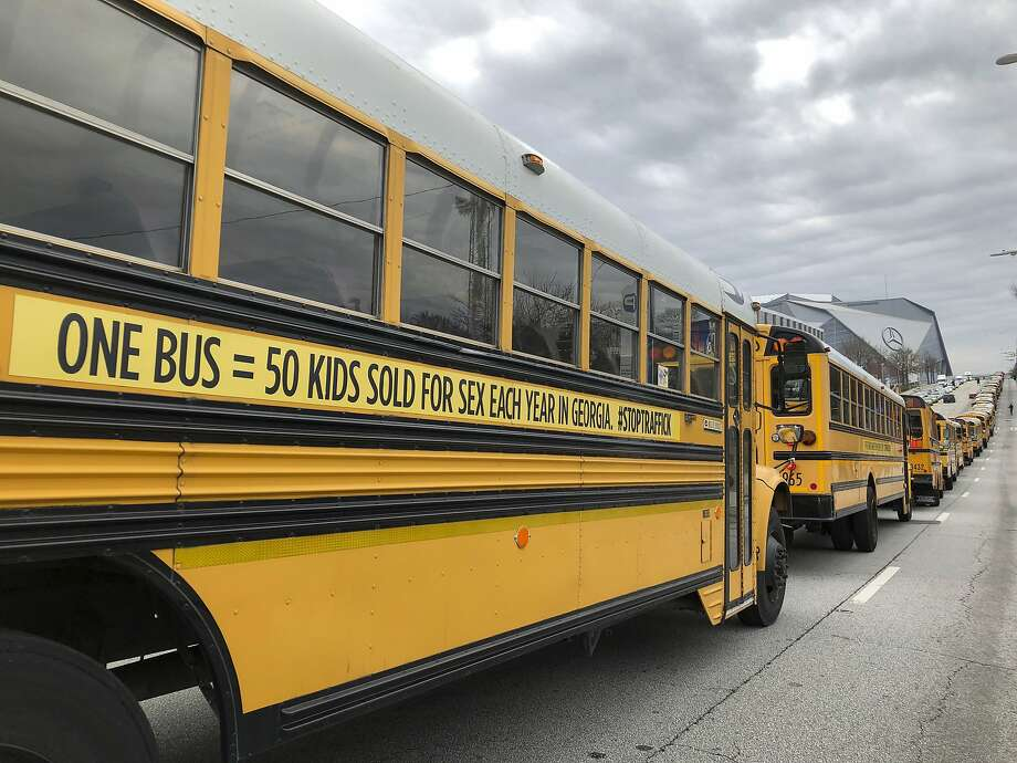 A line of school buses on a road in Atlanta represent the roughly 3,600 children who authorities say are sold into sex slavery every year in the state of Georgia. Photo: Sarah Morgan / Associated Press
