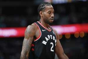 Toronto Raptors forward Kawhi Leonard (2) in the second half of an NBA basketball game Sunday, Dec. 16, 2018, in Denver. The Nuggets won 95-86. (AP Photo/David Zalubowski)