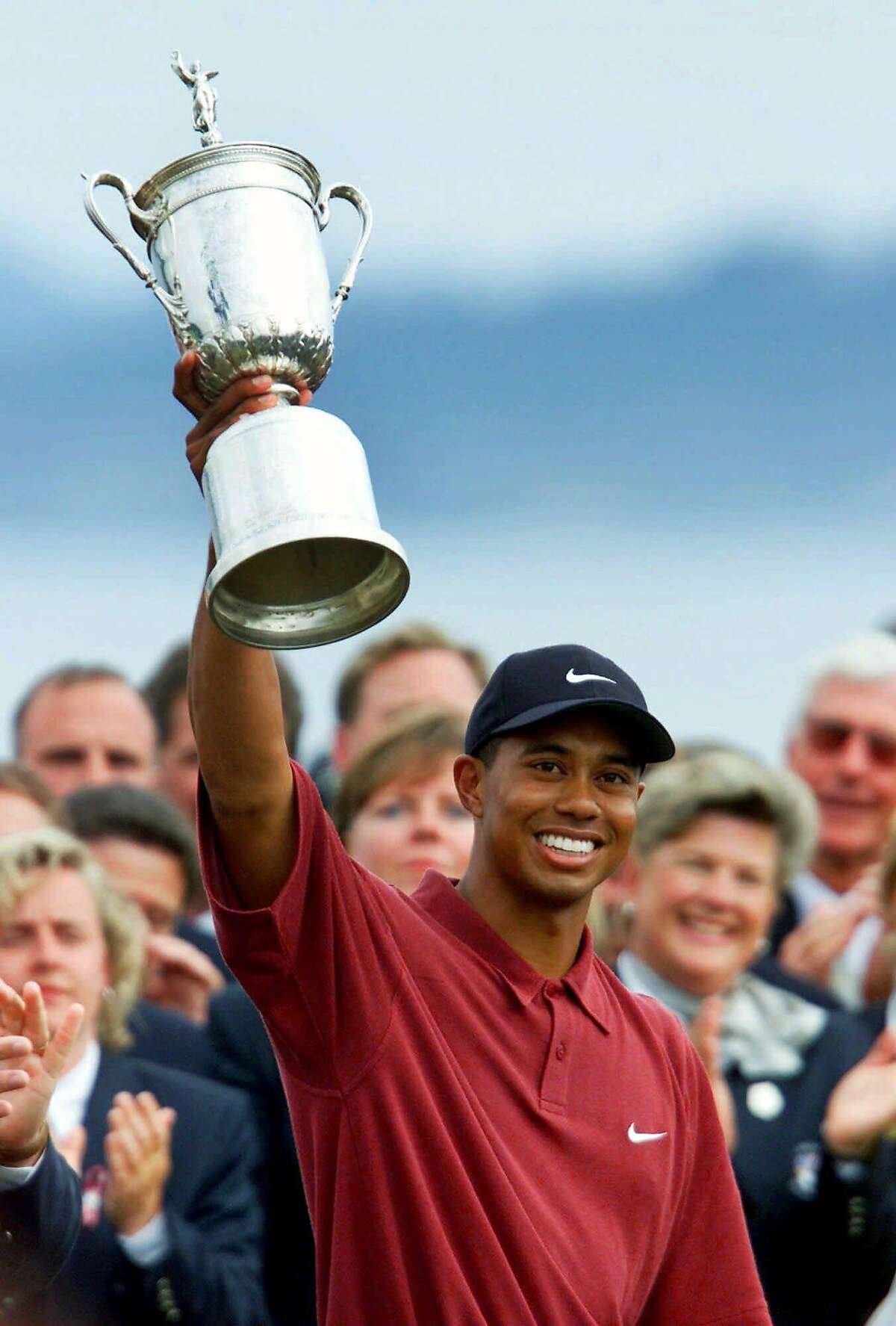 FILE - In this June 18, 2000, file photo, Tiger Woods holds up the trophy after winning the 100th U.S. Open Golf Championship at the Pebble Beach Golf Links in Pebble Beach, Calif. His 15-shot victory in the U.S. Open at Pebble Beach was the most dominant in 140 years of major championships. (AP Photo/Eric Risberg, File0