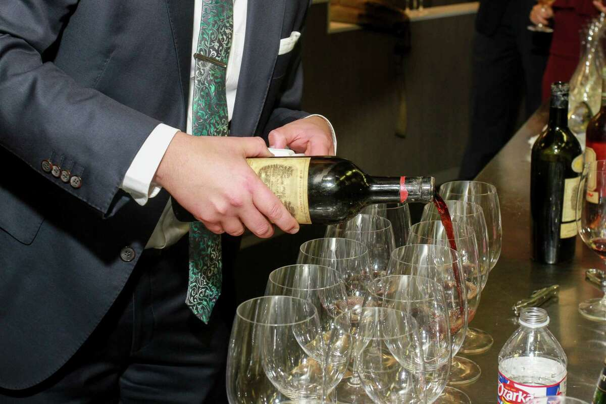 Sommelier Steve McDonald of Pappas Steakhouse pouring a 1928 Chateau Lafite-Rothschild. (For the Chronicle/Gary Fountain, November 1, 2017)