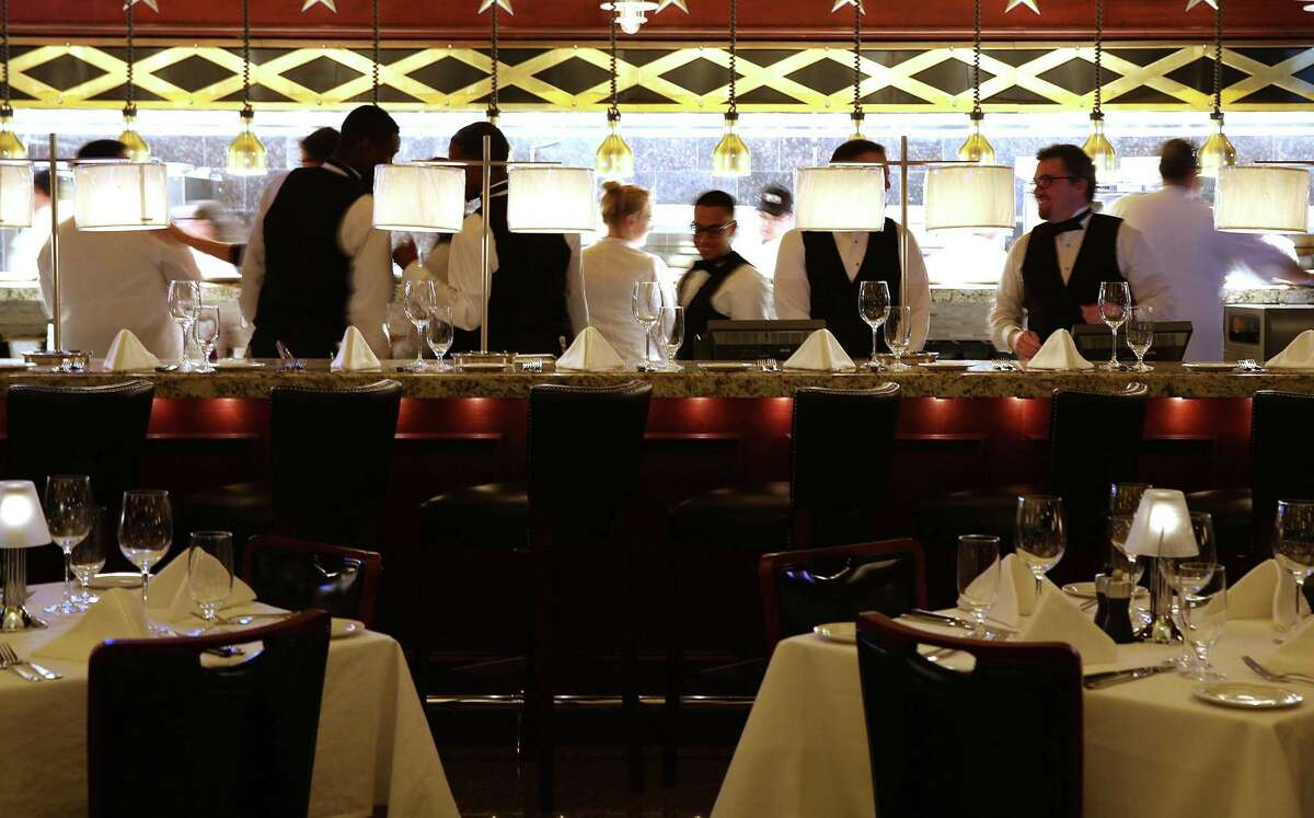 Wait staff and expediters prepare for a practice run through the menu at Pappas Bros. Steakhouse in Houston. Photos of Pappas Bros. Steakhouse as it gets ready to open its long-anticipated downtown dining room taken on Wednesday, Oct. 28, 2015, in Houston. ( Elizabeth Conley / Houston Chronicle )