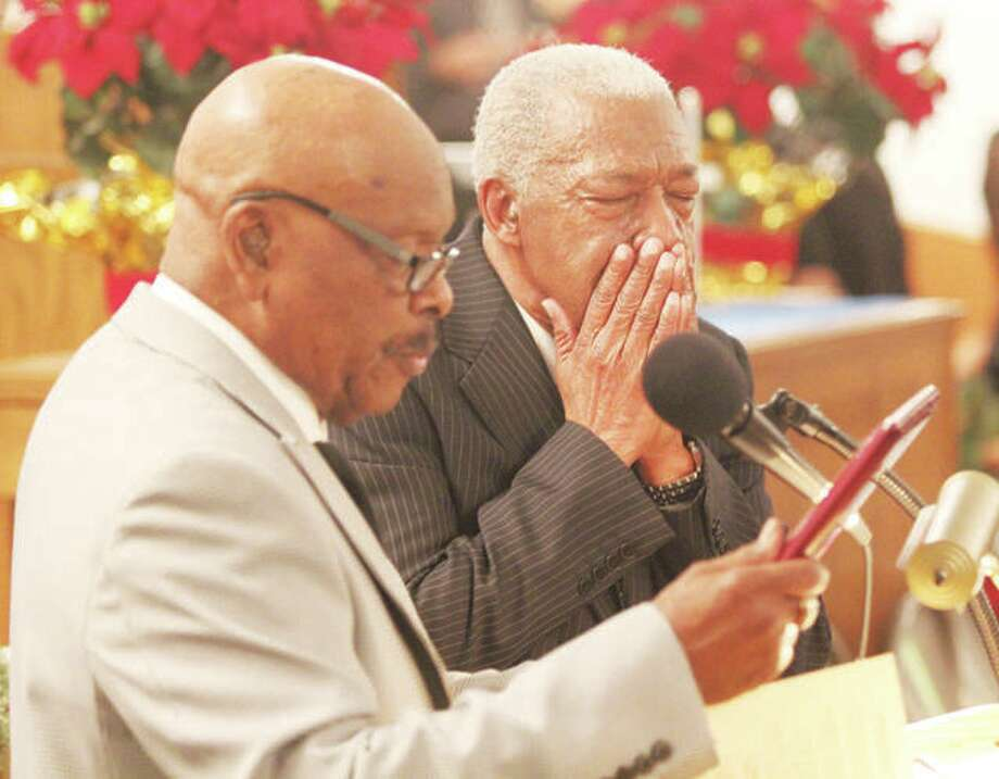Elder Roosevelt Reed, right, reacts while then-Alton NAACP branch President James Gray reads the MLK Award presented to Reed during the group's 36th annual commemoration of the Rev. Dr. Martin Luther King Jr. event in 2016. Photo: Scott Cousins | The Telegraph