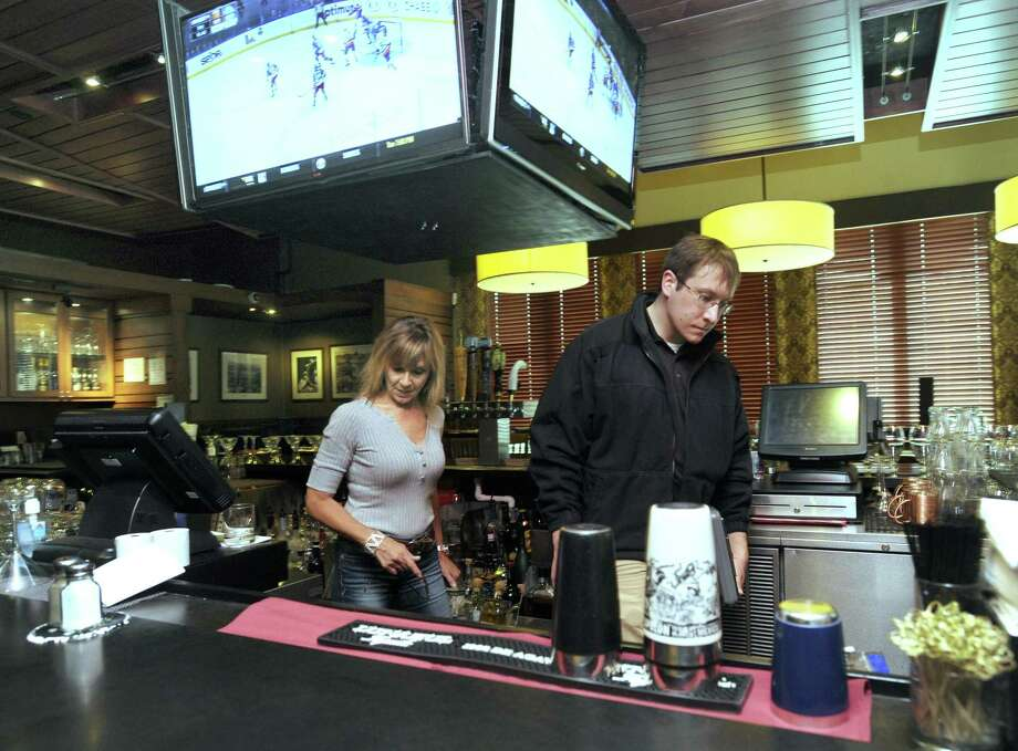 File photo of Karen Barbarie, co-owner of Barbarie's Black Angus Grill, accompanies Ryan Boggan, as he inspects the bar area of the restaurant Monday, March 7, 2016. Photo: Carol Kaliff / Hearst Connecticut Media / The News-Times