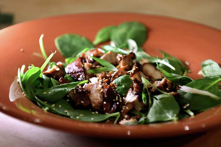 Sticky soy braised chicken thighs served over spinach with green onions and toasted sesame on Thursday, Dec. 27, 2018, from Caroline Barrett in Delmar, N.Y.  (Will Waldron/Times Union) Photo: Will Waldron / 20045708A